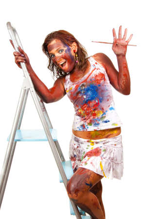 Happy girl makes painting, she is all smeared in paint photo