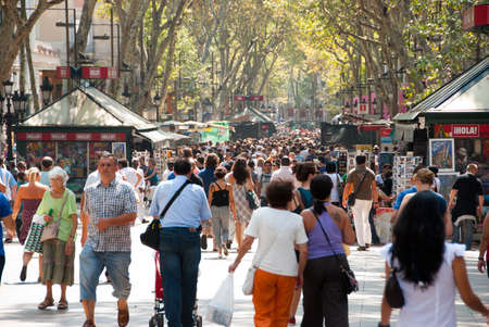 ramblas: BARCELONA - AUGUST 24: People walk by at the famous La Rambla August 24, 2010 in Barcelona, Spain.