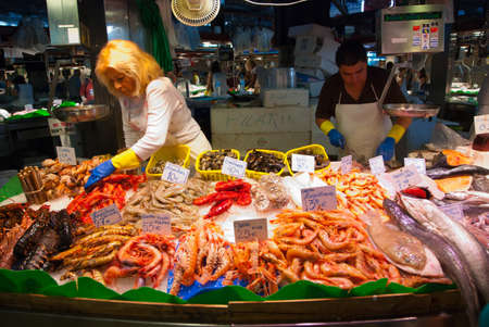 boqueria: BARCELONA - AUGUST 24: Unidentified persons works in a fish shop in La Boqueria market on August 24, 2010 in Barcelona. One of the oldest markets in Europe that still exist. Established 1217.
