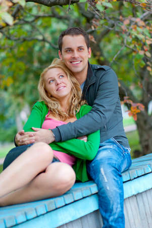 Beautiful young couple relaxing in a park Stock Photo - 8536820