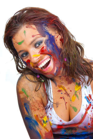 Happy girl, she is all smeared in paint Stock Photo - 8562439