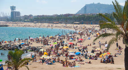 BARCELONA - AUGUST 28: Unidentified people relaxing on the beach on August 28. 2010 in Barcelona, Spain