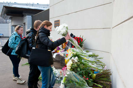 MOSCOW - MARCH 14: Unidentified people bring flowers to the Japanese embassy as a sign of sorrow and sympathy to the Japanese people affected by earthquake on March 14, 2011 in Moscow, Russia. Stock Photo - 9025231