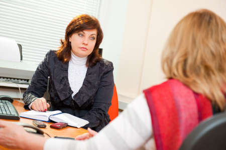 candidate: Businesswoman interviewing a candidate Stock Photo