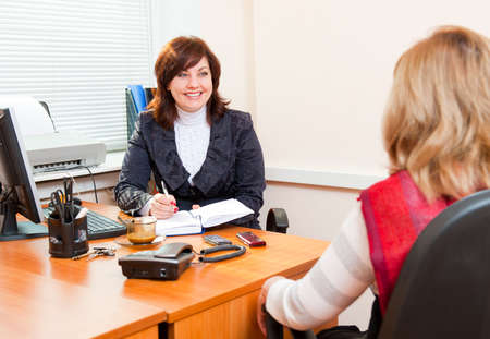 meets: Business woman meets with a colleague on business Stock Photo