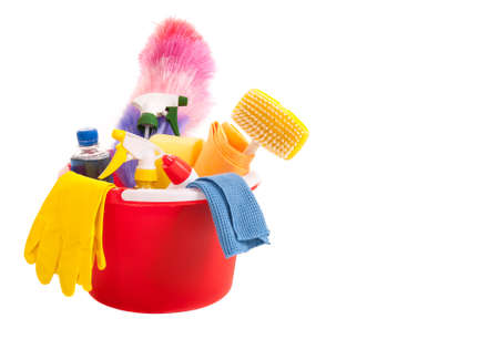 Cleaning tools in a red bucket isolated over white Stock Photo - 9116752