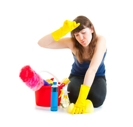 Young woman cleaner tired of work isolated photo