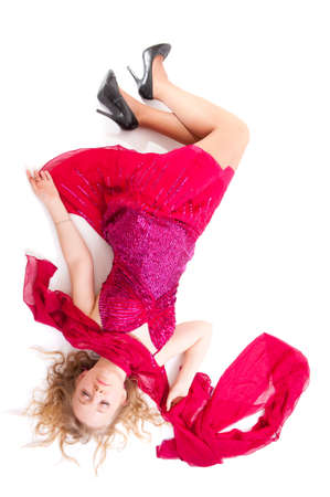 Beautiful girl in red dress sleeping isolated over white Stock Photo - 9173353