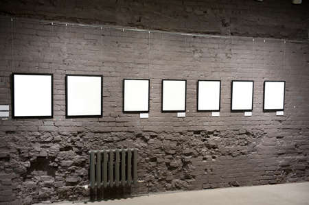 Empty frames on the brick wall in museum  Stock Photo - 9173374