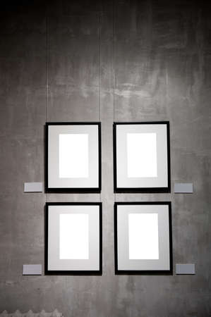 Empty frames on the plaster wall  photo