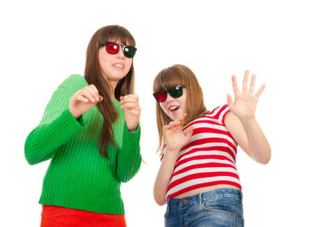 Sisters having fun while watching 3D movie isolated on white background photo