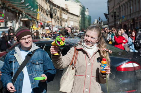 MOSCOW - APRIL 10: Unidentified people having fun on the holiday of spring and bubbles Dreamflash on April 10, 2011 on the famous pedestrian Arbat Street in Moscow