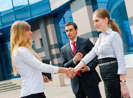 Business people shaking hands in a modern downtown photo