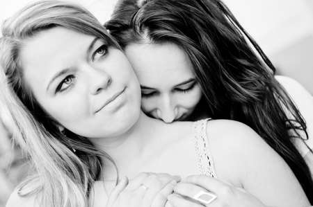 Two young girls black and white portrait photo