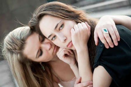 Two sad girls sorry for each other outdoors Stock Photo - 9757789