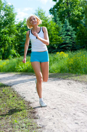 An active beautiful caucasian woman running outdoor in a park Stock Photo - 9755465