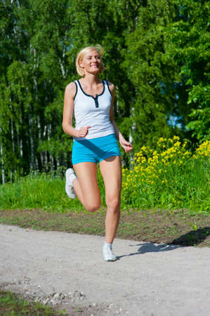 An active beautiful caucasian woman running outdoor in a park Stock Photo - 9755462