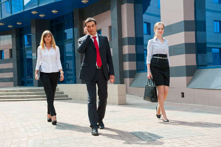 Business people walking in modern city downtown photo