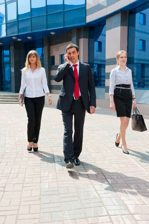 Business people walking in modern city downtown Stock Photo - 9956305