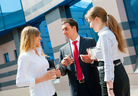 Business people have a coffee break in a modern downtown. Stock Photo - 10065375