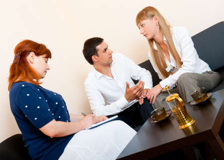 Young married couple consults at the psychologist Фото со стока