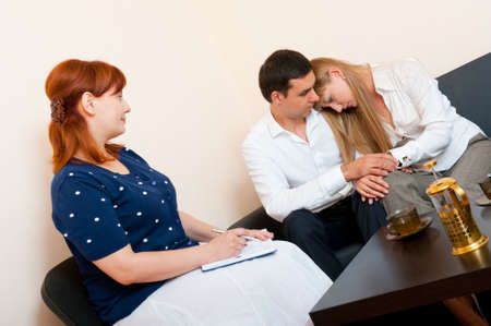 Young married couple consults at the psychologist photo