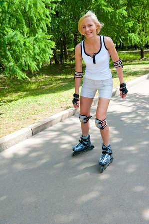 rollerskates: Girl roller-skating in the park at summer