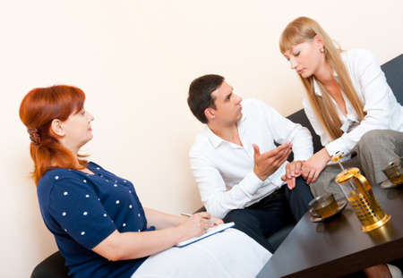 couples therapy: Young married couple consults at the psychologist Stock Photo