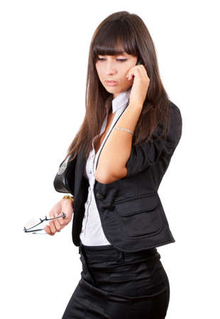 Young business woman speaking by mobile phone photo