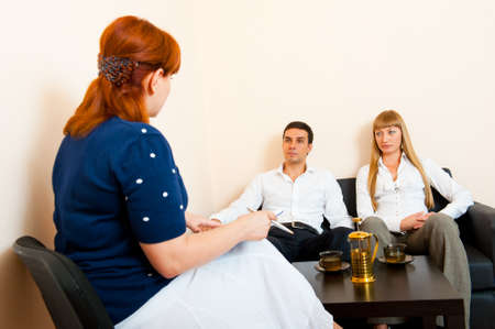 marriage counseling: Young married couple consults at the psychologist Stock Photo