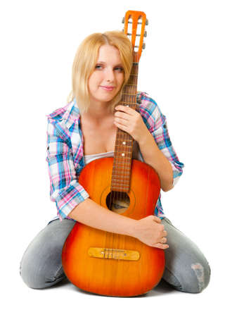 Girl with a guitar sitting on a white background photo