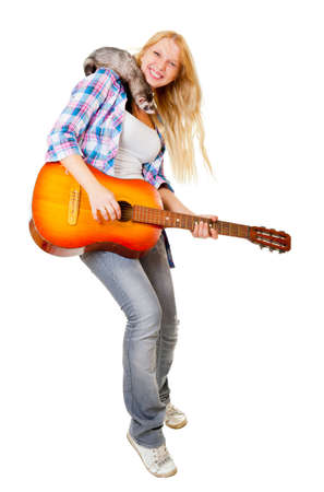 Girl playing the guitar, on her shoulder sits a ferret Stock Photo - 10770479