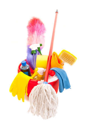Cleaning tools in a red bucket isolated over white