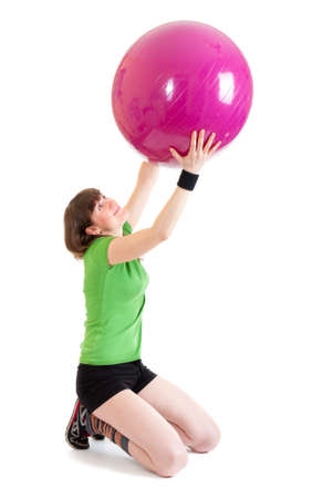 Young woman doing exercises with a big ball Stock Photo - 10770511