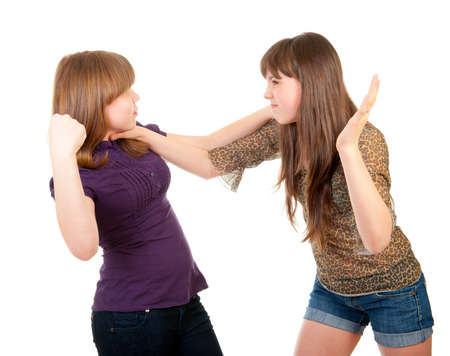 Fighting teen girls isolated over white background