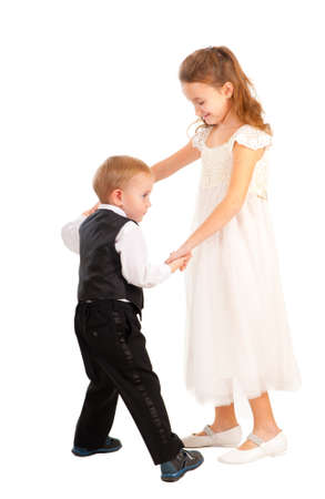 Boy and girl learning to dance isolated over white photo