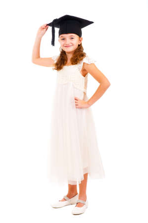 Girl dressed Bachelor cap isolated over white photo