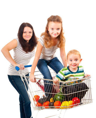 Mother carries her children in a shopping cart isolated over white photo