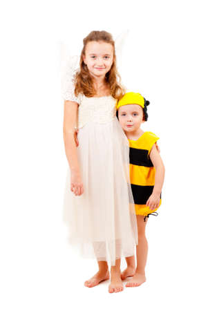 Brother and sister in carnival costumes isolated over white photo
