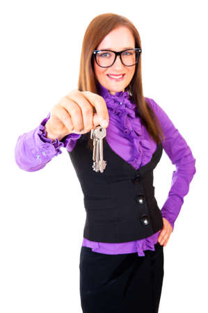 Realtor handing the keys isolated over white. Focus to key. photo