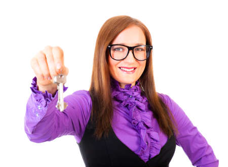 Realtor handing the keys isolated over white. Focus to face. photo