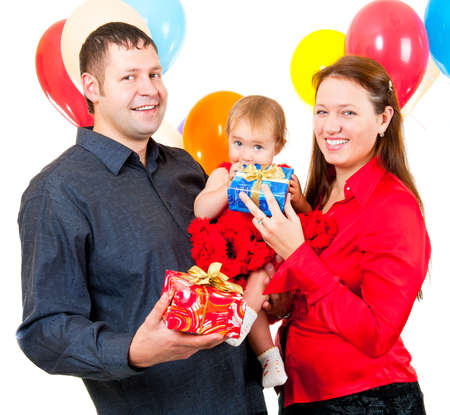 Parents celebrate their daughters birthday and give her gifts photo