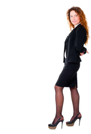 leaning over: Successful leaning business woman full length portrait. Isolated over white background