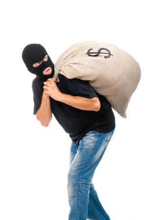 Happy robber carries sack full of dollars isolated on white photo