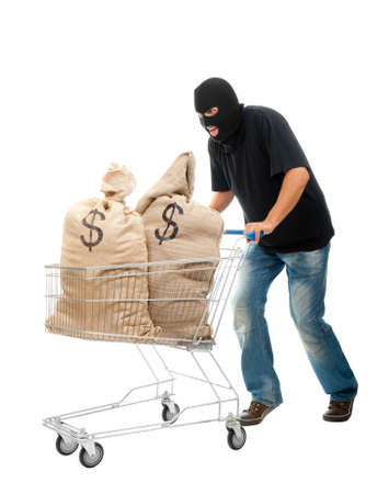 stealer: Lucky robber carries in two sacks full of dollars the shopping cart. Isolated over white.