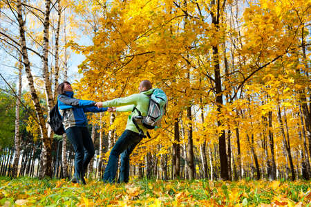 Happy young couple with backpacks in the park. Fall. Stock Photo - 11620966
