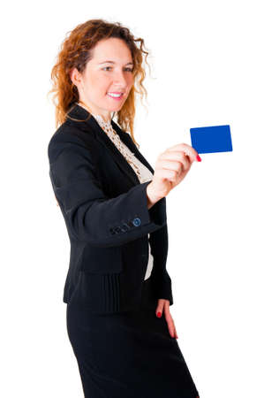 Happy satisfied business woman holds out her credit card isolated on white background photo