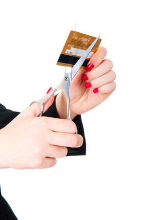 Hands ready to scissor a credit card. Isolated over white photo