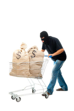 stealer: Lucky robber carries two sacks full of dollars in the shopping cart. Isolated over white.