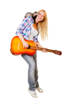 Girl playing the guitar, on her shoulder sits a ferret Stock Photo - 12274903